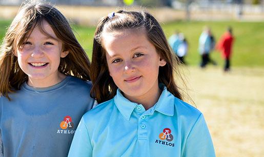 Two Athlos girl students in school uniform